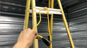 tie your cord to the top bar of your step ladder