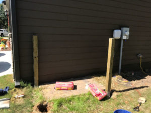 two treated 4x4 posts embedded in concrete