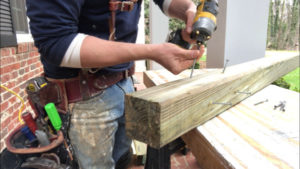drill screws into porch post at angle to make railings stronger