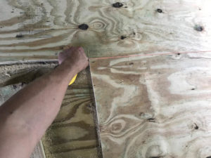 Use a chalk box to snap cut guidelines on treated plywood