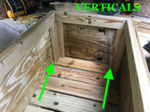 install wooden vertical supports at inner corners of planter boxes