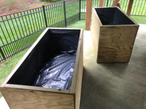 line planter box interiors with heavy 6 mil plastic