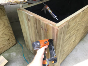 rip wood trim pieces to custom widths to create square corners on custom planter boxes