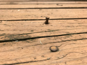 loose nail sticking up out of deck