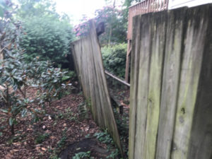 Badly detached and sagging privacy fence section