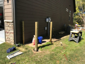 set three treated 4x4 posts in concrete in post holes around patio pad