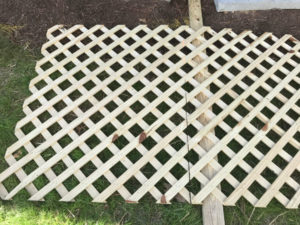 mark and cut treated lattice with circular saw