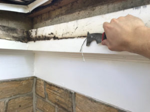 scrape caulk with painter's tool