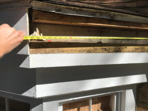 measure for new fascia board with tape measure