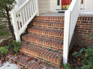 masonry stairs with wooden railings at correct stair angle