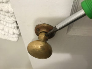 tighten loose old door knobs with a screwdriver