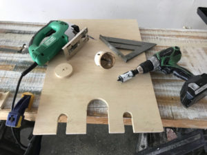 cut clearance for pipes in plywood using jigsaw or hole saw bits and electric drill