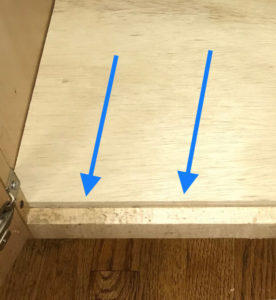 plywood edge in cabinet is left exposed and must be covered up with pine trim wood