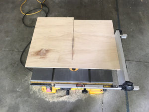 cut plywood panel to width and length using table saw or circular saw