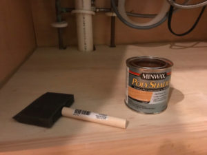 use stain or paint to finish new cabinet floor for wood rot protection