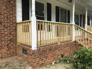 New railings attach directly to the new porch column
