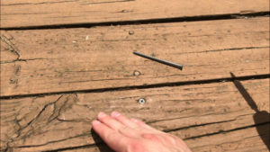 replacement deck screw driven in where old nail used to sit