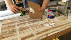 transfer bondo putty onto a cardboard mixing surface