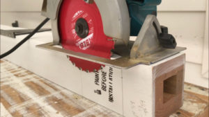 Set the circular saw blade depth to cut the new wood porch column