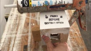 caulk the bottom of the new wood porch column