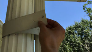 with rivets removed, pry apart gutter components carefully