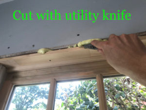 Cut exposed foam with a utility knife and break it off