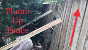 Plumb up fence with 2x4s for leverage