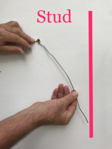 clothes hanger shows wall stud location