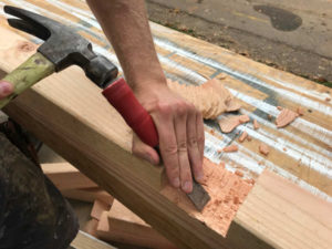 knock down hard spots in crosslap with hammer and wood chisel