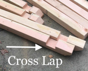 empty and leaned cross lap pieces in cedar wood