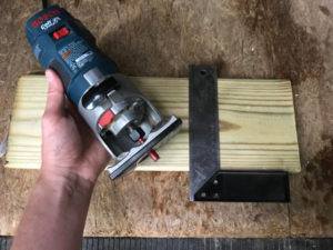 straight bit in router with wood and combination square