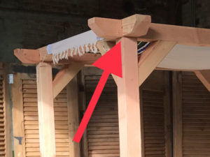 crosslap lifts in place on wedding arbor